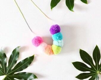 Pastel rainbow Pom pom necklace on pastel ombre cord