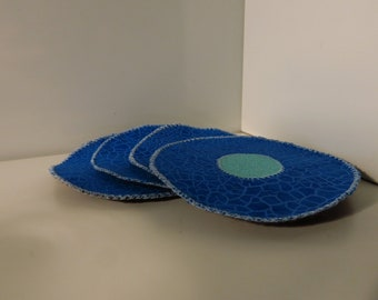 Set of 4 fabric, circular, quilted, sewn dark and light blue coasters