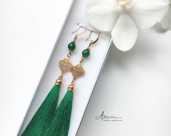 Long earrings with tassels and jade beads