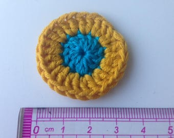 Yellow and turquoise rosette crochet flower