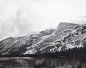 Reverse charcoal drawing of California mountain and lake