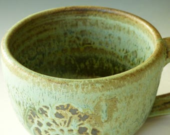 verdigris green cup and saucer with queen anne's lace design