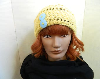 Bright yellow hat with baby blue buttons