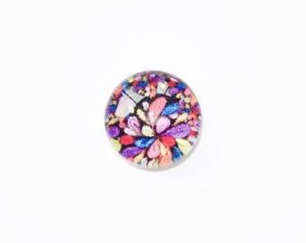 Glass cabochon featuring 10mm multicolored pattern