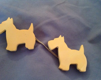 Two Vintage matching yellow Bakelite Scottie dog brooches