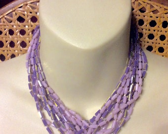 Vintage Hong Kong multi strand lavender purple acrylic beads necklace.