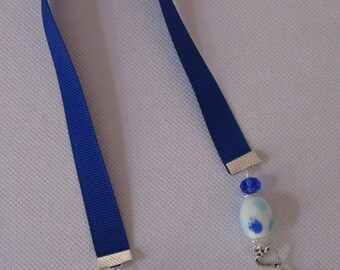 Blue ribbon book mark with glass beads and silver coloured key charm. Double ended ribbon book mark.