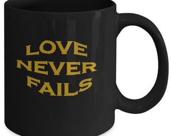 Love Never Fails Coffee Mug