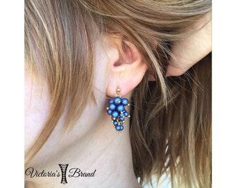 Swarovski pearls stud earrings.