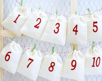 Advent Calendar - Garland Kit With Mini Clothespins and String - 25 Numbered Christmas Countdown - Small Fabric Bags with Sparkling Numbers