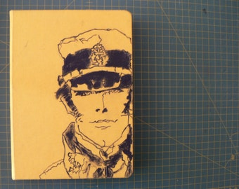 Handmade notebook, elastic closure. Hand painted illustration on the cover. Corto Maltese!