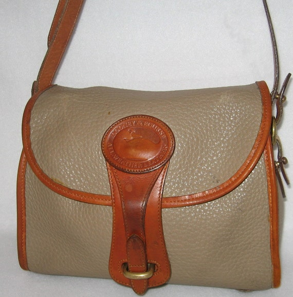 https://www.etsy.com/listing/125058822/vintage-dooney-and-bourke-purse-all?ref=shop_home_active_9