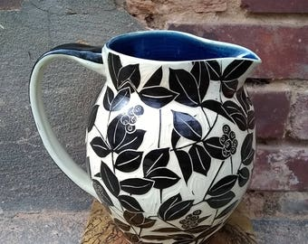 Blue Berry Pitcher. Sgraffito blue berries.