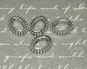 4 beads, oval hollowed silver-plated 11 x 13, 5 x 3, 5mm