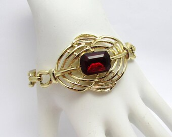 "S&G 5th Ave Cuff Bracelet - gold tone, ruby red glass stone - 6-3/4"" long - ca 1950s"
