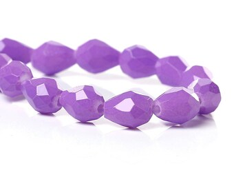 A set of six glass beads faceted Purple Purple drops.