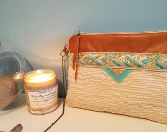 Clutch bag in leather and cotton weaving effect