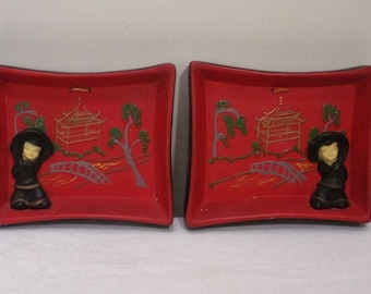 Vintage Asian Red and Black Chalkware Wall Plaques