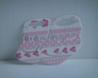 Cutout paper napkin for scrapbooking or card baby shoes
