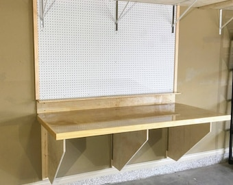 DIY Folding Workbench Plans - Easy to Follow Plans to build a sturdy space saving workbench for your garage, craft room, or shop.