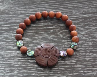 Sandalwood diffuser bracelet with Paua shell beads and wooden flower focal bead. Free domestic shipping