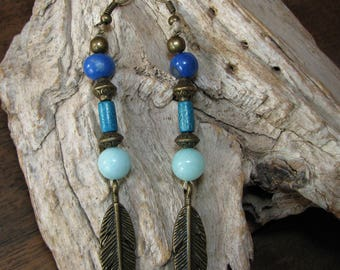 Linen, bronze feather earrings and blue beads