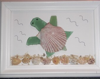Seaglass green turtle with shells and sand on bottom picture