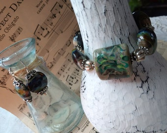 Beautiful Handmade Black and Teal Lampwork, leather and Indonesian Seed Bead three stranded bracelet and earrings set!