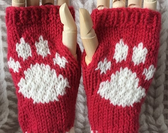 Hand knitted red/white paw print wrist warmers