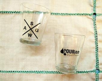 2 Vintage shot glasses, shot / nip glasses, clear glass, logo, whiskey, alcohol glasses, collector, man cave, entertaining, bar display