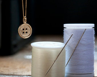 Button Pendant in solid 14 Karat Gold from the Everyday Icons Collection. Designer jewelry from Ireland. Hallmarked in Dublin Castle.