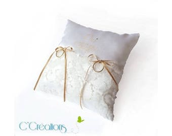 A so romantic wedding ring pillow in white satin and tulle lace