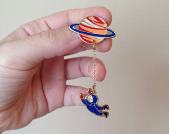 Vintage Enamel Lapel Pin - Astronaut Orbiting Planet Saturn - Cute Astronaut Dangling by Chain from Planet Saturn Pin Brooch