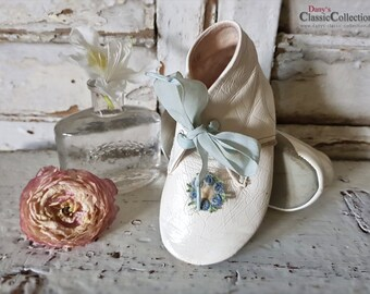 Sweet baby booties in white patent leather with light blue flower rosette on top ~ vintage pair of baby shoes ~