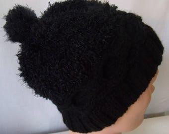 Twisted Hat faux fur in black color.
