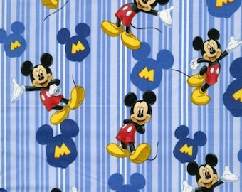 Disney Mickey Mouse in Blue Stripes Cotton Fabric sold by the yard and by the half yard