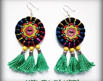 Black felt earrings and green tassels