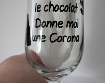 """Beer glass with """"give me chocolate let a Corona."""