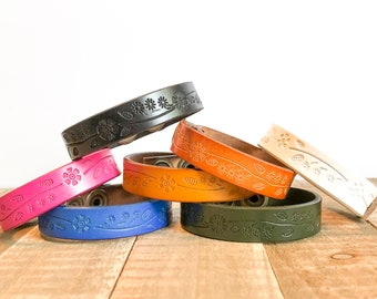 your words cuffs - custom hand stamped leather belt bracelet - personalized with your words - skinny leather cuff - flower cuff