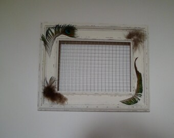Earrings display, frame and wooden peacock feathers