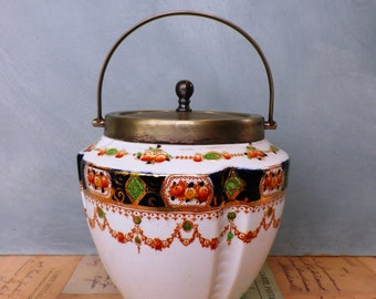 An Edwardian China Biscuit Barrel or Cookie Jar with EPNS lid and handle in a pretty classic swagged design 'Mona' Made in England u