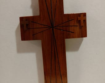 wood burnt cross with little crosses attached