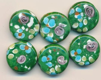 Six gorgeous spring-like lampwork glass beads - semi-matte variegated green background with flowers - 20 mm flat disks