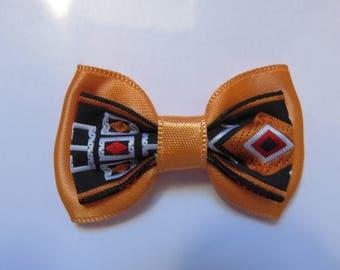 Metal strip 5 cm with bowtie print and orange satin fabric