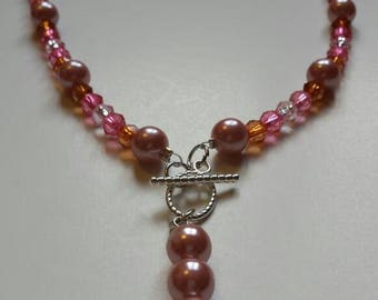 Pink pearl beaded necklace with Amber, dark and light pink glass beads.