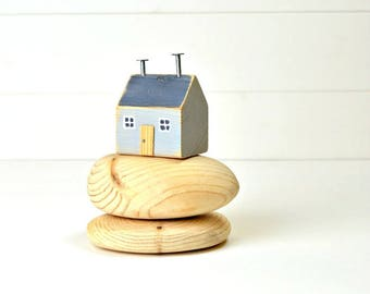 Grey House On Pebbles