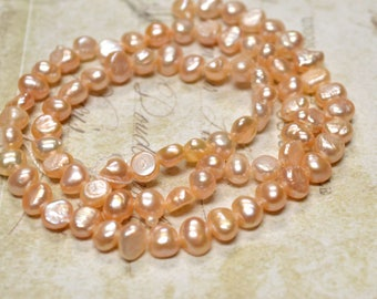 Pearl Cultured Freshwater Peach 6-7mm Flat-Sided Round C Grade 16in Strand