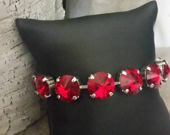 Red Swarovski Crystal Tennis Bracelet with 12mm Crystals in a Rhodium Plated Setting