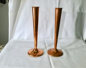 Pair of copper fluted candlestick holders