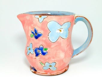 Small floral Earthenware pitcher/creamer. Wheel thrown and altered, food safe, made by Kaitlyn Brennan/ Brennan pottery